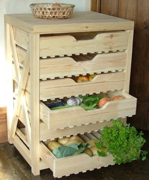 Wooden apple rack filled with fruit and vegetables